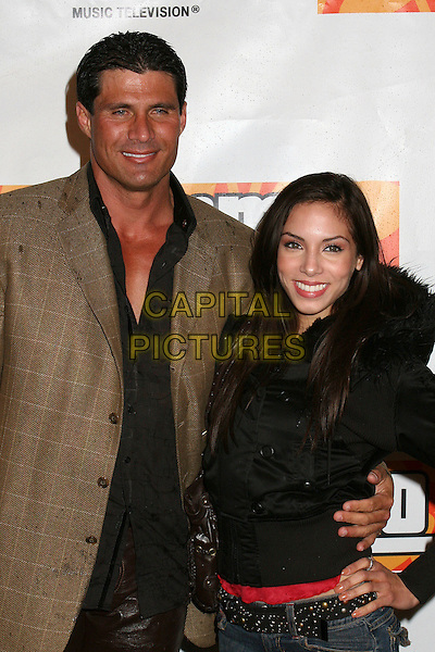 """JOSE CANSECO & YEFANNIA ADAMS.Premiere Party for MTV's """"Yo Momma"""" at Privilege, Hollywood, California, USA..Macrh 20th, 2006.Photo: Byron Purvis/AdMedia/Capital Pictures.Ref: BP/ADM.half length Canseco conseco canceco cansaco black brown.www.capitalpictures.com.sales@capitalpictures.com.© Capital Pictures."""