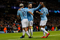 Sergio Aguero of Manchester City celebrates with Bernardo Silva of Manchester City and Raheem Sterling of Manchester City after scoring his side's second goal to make the score 2-0 during the UEFA Champions League Round of 16 second leg match between Manchester City and Schalke 04 at the Etihad Stadium on March 12th 2019 in Manchester, England. (Photo by Daniel Chesterton/phcimages/Insidefoto)
