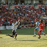 12 September 2009:  Toronto FC forward O'Brian White #17 shoots a ball over Colorado Rapids goalkeeper Preston Burpo #17 scoring Toronto FC's second goal during MLS action at BMO Field Toronto in a game between Colorado Rapids and Toronto FC. .Toronto FC won 3-2..
