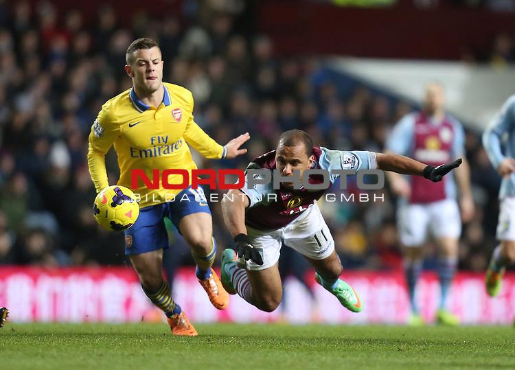 Aston Villa's Gabriel Agbonlahor is tackled by Arsenal's Jack Wilshere -  13/01/2014 - SPORT - FOOTBALL - Villa Park - Birmingham - Aston Villa v Arsenal - Barclays Premier League<br /> Foto nph / Meredith<br /> <br /> ***** OUT OF UK *****