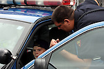 The Wisconsin State Patrol Officer talking to a young boy in the vehicle at the Menomonee Falls Fire and Police Department Safety Fair
