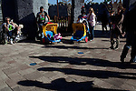People stand outside The King's Market while they wait for their friends and family members to ride The Dragon roller coaster in Legoland in Whitehaven, Florida on February 11, 2012.