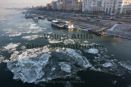 Ships are seen anchored among floating ice blocks on river Danube in Budapest, Hungary on January 11, 2017. ATTILA VOLGYI