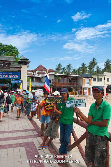 Hotel agents holding signs with the names in the port of Phi-Phi, Thailand