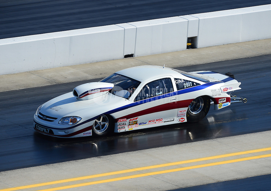 Apr. 14, 2012; Concord, NC, USA: NHRA competition eliminator driver Russell during qualifying for the Four Wide Nationals at zMax Dragway. Mandatory Credit: Mark J. Rebilas-