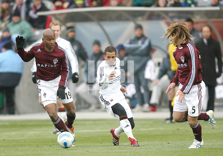 Fred cuts a path for the ball between Roberto Brown and Kyle Beckerman of the Rapids. In their first game in their new stadium Colorado Rapids held on to beat DC United 2-1 at Dick's Sporting Goods Park in Commerce City, Colorado on April 7 2007 before the first sellout crowd in Rapids history.