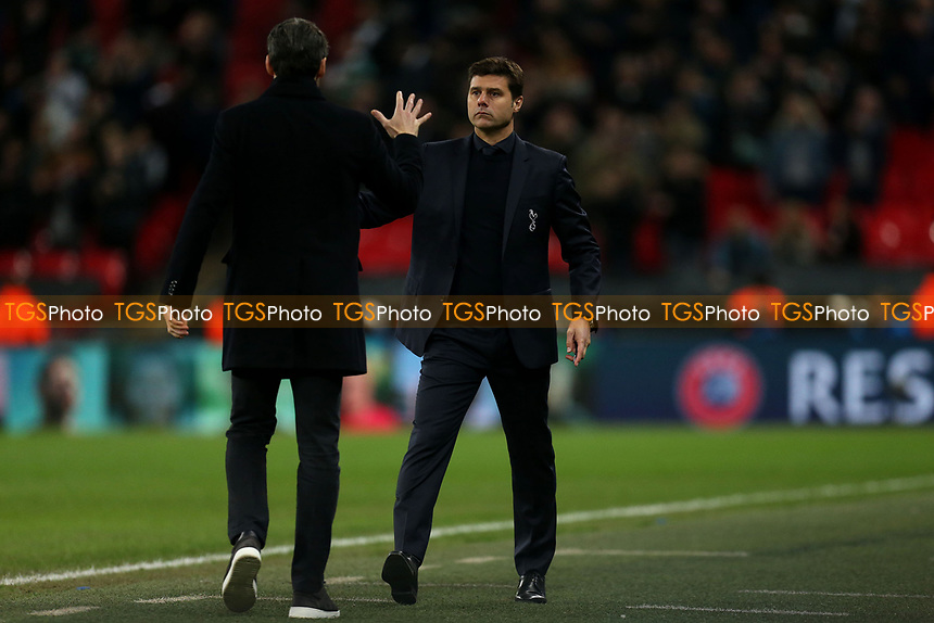 Tottenham Hotspur manager Mauricio Pochettino and PSV Eifhoven manager Mark van Bommel after Tottenham Hotspur vs PSV Eindhoven, UEFA Champions League Football at Wembley Stadium on 6th November 2018