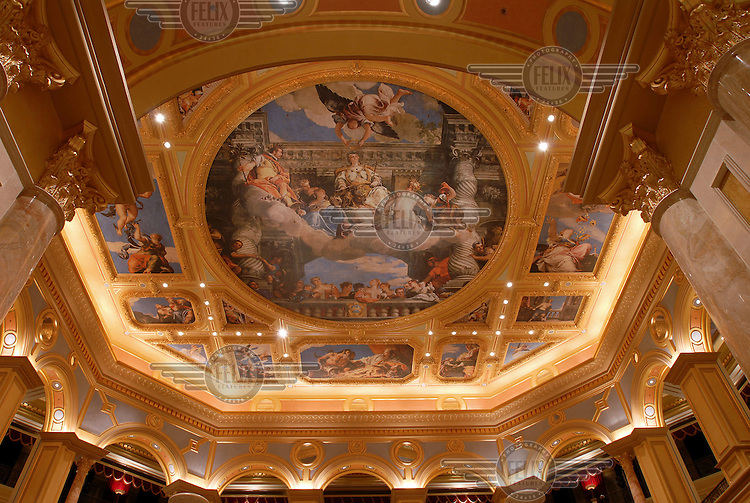 Elaborately painted mural in the Venetian Macau Resort Hotel, owned by Las Vegas Sands Group. The integrated resort contains the world's largest casino, with over 800 gaming tables and some 4,000 slot machines, as well as a 3,000 room hotel. Costing in the region of 2.4 billion USD, the hotel/casino is the world's largest occupied building.