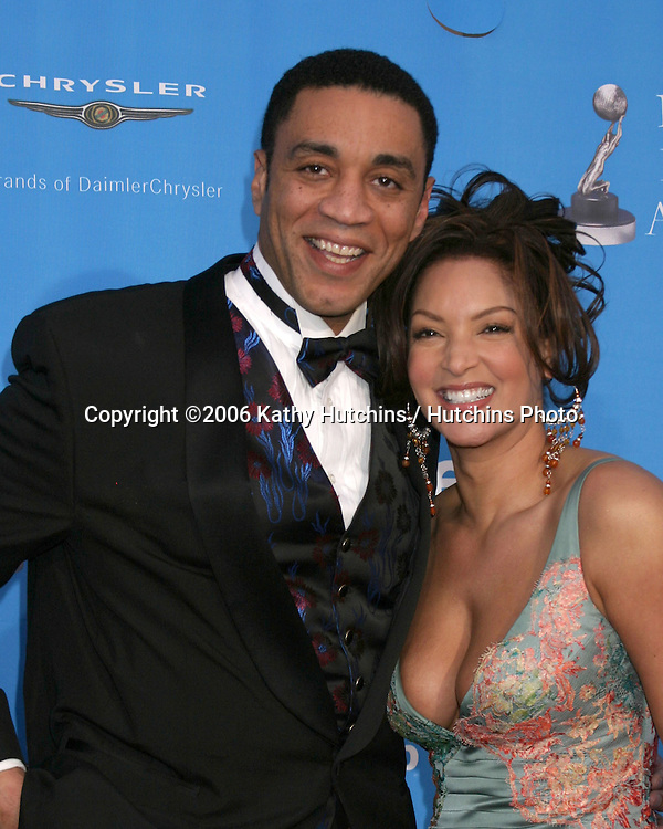 Harry Lennix and guest.37th NAACP Image Awards.Shrine Auditorium.Los Angeles, CA.February 25, 2006.©2006 Kathy Hutchins / Hutchins Photo....