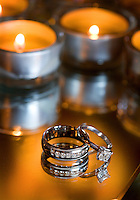 A couple's wedding rings sit in the orange glow of tea lights. (Photo by Scott Eklund/Red Box Pictures)