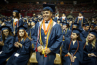 NWA Democrat-Gazette/DAVID GOTTSCHALK  Erol Banuelos stands to be recognized Friday, May 19, 2017, as a Distinguished Honors Graduate, during commencement exercises for Rogers Heritage High School at Bud Walton Arena on the campus of the University of Arkansas in Fayetteville. There are 437 graduates from the Rogers Heritage High School class of 2017. Visit nwadg.com/photos to see more photographs from the ceremony.