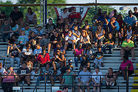 Fans sit in the grandstands behind the first base dugout during the Appalachian League game between the Princeton Rays and the Burlington Royals at Burlington Athletic Stadium on June 24, 2016 in Burlington, North Carolina.  The Rays defeated the Royals 16-2.  (Brian Westerholt/Four Seam Images)