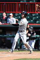 Akron RubberDucks outfielder Tyler Naquin (4) at bat during a game against the Erie SeaWolves on May 18, 2014 at Jerry Uht Park in Erie, Pennsylvania.  Akron defeated Erie 2-1.  (Mike Janes/Four Seam Images)
