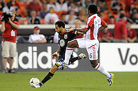 D.C. United forward Dwayne de Rosario (7) goes against Toronto FC midfielder Julian de Guzman (6)  D.C. United defeated Toronto FC 3-1 at RFK Stadium, Saturday May 19, 2012.