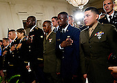 Active duty service members listen to the National Anthem prior to United States President Barack Obama delivering remarks at a naturalization ceremony in their honor in the East Room of the White House in Washington, D.C. on Wednesday, July 4, 2012..Credit: Ron Sachs / Pool via CNP