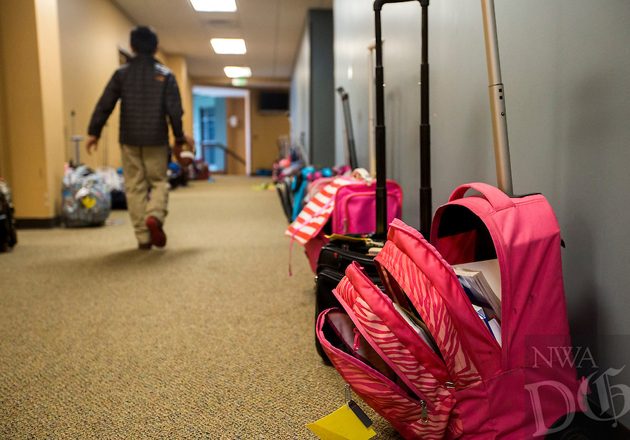 NWA Democrat-Gazette/JASON IVESTER<br /> Due to space issues, some students leave their book bags in the halls outside their classrooms at Providence Academy in Rogers.