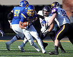 BROOKINGS, SD - DECEMBER 2: Isaac Wallace # 35 from South Dakota State looks for room past Adam Reth #99 from Northern Iowa during their FCS Division 1 playoff game Saturday afternoon at Dana J. Dykhouse Stadium in Brookings, SD. (Photo by Dave Eggen/Inertia)