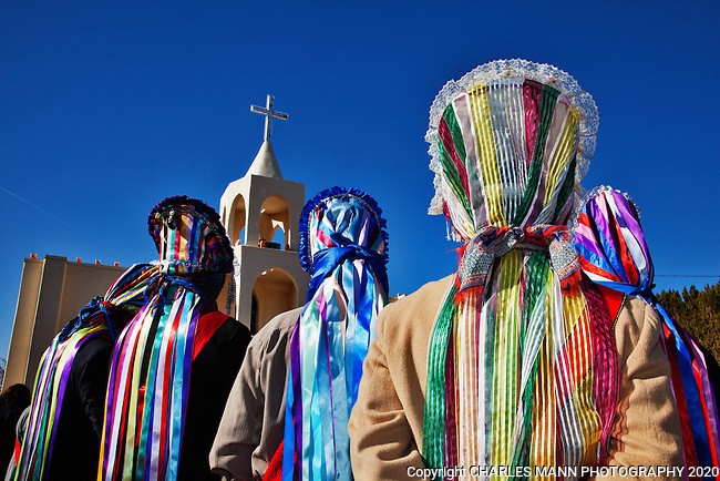 The villa of Tortugas near Las Cruces, New Mexico, celebrates the Virgin of Guadalupe Feast day each year on the traditional dates of December 10-12 with prayers, matchine dancers, a pilgrimage, and colorful Chichimecca dancers.Matachine dancers await thier moment to dance .