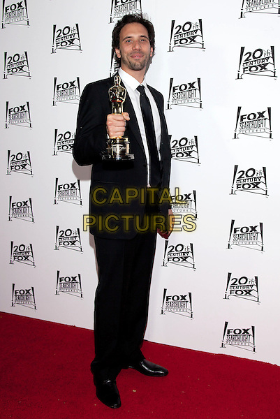 Erik De Boer.2013 Twentieth Century Fox & Fox Searchlight Pictures Oscar Party held at  Lure, Hollywood, California, USA..February 24th, 2013.oscars full length black white shirt tie award trophy winner stubble facial hair .CAP/ADM/DAN.©Dan Scott/AdMedia/Capital Pictures.