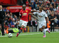 Pictured L-R: Ashley Young of Manchester United closely marked by Wayne Routledge of Swansea. Saturday 16 August 2014<br />