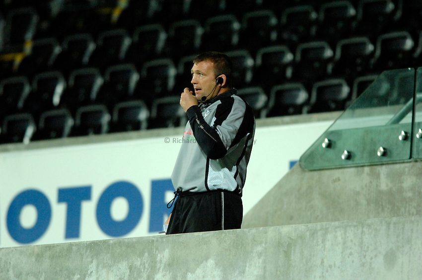 Photo: Richard Lane..Ospreys v Gloucester Rugby. EDF Anglo-Welsh Cup. 29/09/2006. .Ospreys' forwards coach, Jon Humphreys watches on.