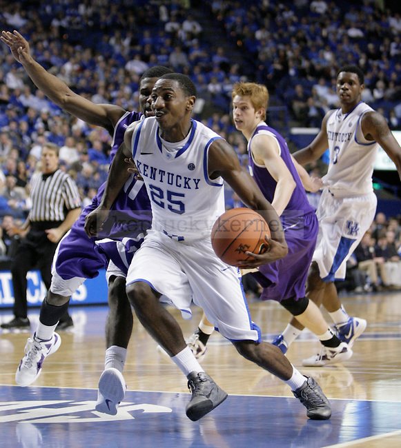 Marquis Teague drives to the basket against Portland at Rupp Arena on Saturday, Nov. 26, 2011. Photo by Scott Hannigan | Staff