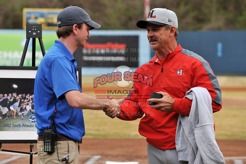 Former Asheville Tourists manager and current Texas Rangers roving instructor Joe Mikulik is presented his 2012 Sally League championship ring by Tourists President Brian DeWine before a game between the Hickory Crawdads and the Asheville Tourists at McCormick Field on April 17, 2013 in Asheville, North Carolina. The Crawdads won the game 6-5. (Tony Farlow/Four Seam Images).