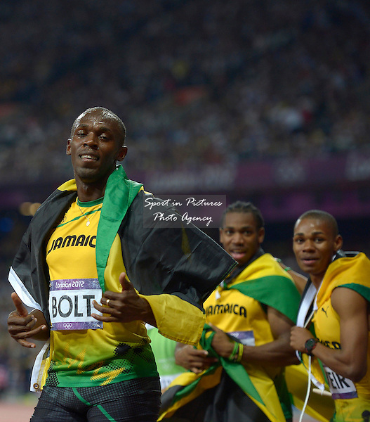 Jamaica's Usain Bolt with Jamaica's Yohan Blake (centre) and Jamaica's Warren Weir. All three medalists. Athletics - PHOTO: Mandatory by-line: Garry Bowden/SIP/Pinnacle - Photo Agency UK Tel: +44(0)1363 881025 - Mobile:0797 1270 681 - VAT Reg No: 768 6958 48 - 08/08/2012 - 2012 Olympics - Olympic Stadium, Olympic Park, London, England