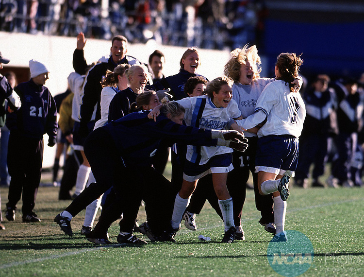 7 Dec. 1997: The University of North Carolina bench celebrates after forward Robin Confer (7) scores the second goal of the game during the Division 1 Women's Soccer Championships on Campus Field at the University of North Carolina-Greensboro. The Tarheels of UNC defeated the University of Connecticut 2-0 to win the national championship. Jim Gund/NCAA Photos.