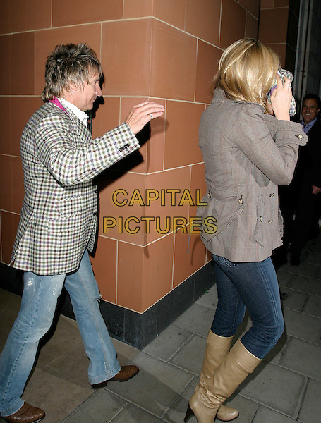 ROD STEWART & PENNY LANCASTER.Leaving Cipriani Restaurant, London, UK..October 19th, 2006.Ref: AH.full length grey gray jacket jeans denim tucked into beige boots hiding covering face couple tweed.www.capitalpictures.com.sales@capitalpictures.com.©Adam Houghton/Capital Pictures.
