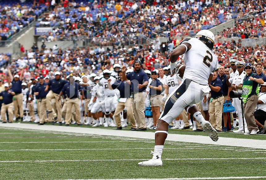 Navy Midshipmen safety Parrish Gaines (2) catches an interception just shy of the end zone during the second quarter of the college football game between the Ohio State Buckeyes and the Navy Midshipmen at M&T Bank Stadium in Baltimore, Saturday afternoon, August 30, 2014. The Ohio State Buckeyes defeated the Navy Midshipmen 34 - 17. (The Columbus Dispatch / Eamon Queeney)