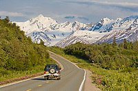 Car travels through the Alaska Range mountains on the Richardson Highway, Interior, Alaska.