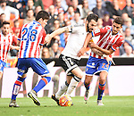 Valencia CF's   Alvaro Negredo and Sporting de Gijon's  Jorge Mere and Rachid during La Liga match. January 31, 2016. (ALTERPHOTOS/Javier Comos)