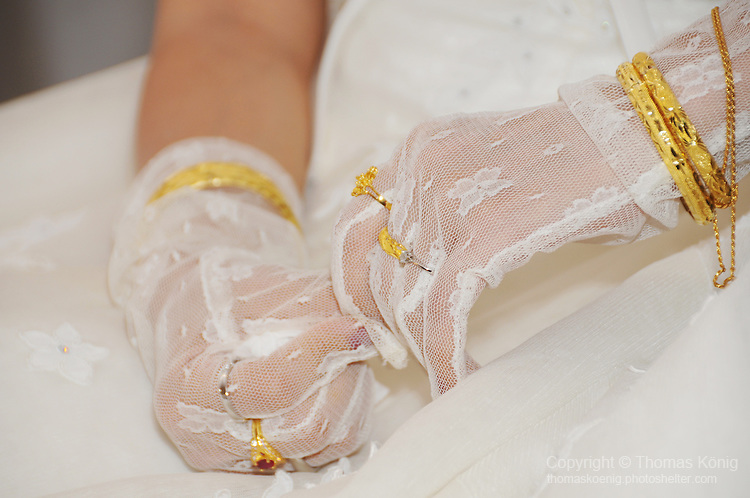 Taiwanese Wedding -- Gold rings and bracelets.