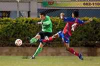 Josh Lambo (18) kicks the ball against Josue Martinez (17). Costa Rica defeated the US Under 20 Men's National team 3-0 during the 2009 CONCACAF U-20 Championship game at Marvin Lee Stadium Trinidad & Tobago in Macoya, Trinidad on March 17th, 2009.