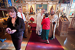 Fr. Stephen Tumbas administers Holy Communion to the faithful during, Christmas Liturgy Service, St. Sava Serbian Orthodox Church, Jackson, Calif.