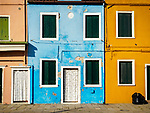 Yellow, orange, blue, windows. The colorful village of Burano, Italy.