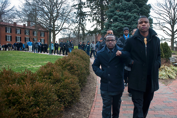 Alpha Phi Alpha members Terence Robertson (left) and Walter Dillard lead marchers in the 13th annual Alpha Phi Alpha  silent march held in honor of Dr. Martin Luther King on monday. The marchers walked silently from Galbreth Chapel to Baker University center where they attended a brunch. Photo by: Ross Brinkerhoff