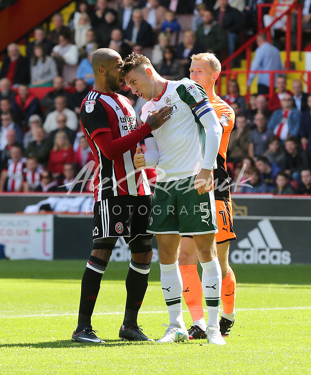 Sheffield United VS Barnsley FC EFL CHAMPIONSHIP <br /> Saturday 19th August 2017, Bramall Lane Sheffield<br /> <br /> Barnsleys Angus McDonald lands a headbut on Sheffield Uniteds Leon Clarke<br /> <br /> Picture - Alex Roebuck / www.alexroebuck.co.uk
