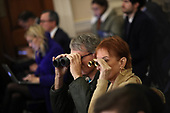 Members of the audience use binoculars while attending an impeachment hearing where constitutional scholars testified before the US House Judiciary Committee in the Longworth House Office Building on Capitol Hill December 4, 2019 in Washington, DC. This is the first hearing held by the House Judiciary Committee in the impeachment inquiry against U.S. President Donald Trump, whom House Democrats say held back military aid for Ukraine while demanding it investigate his political rivals. The Judiciary Committee will decide whether to draft official articles of impeachment against President Trump to be voted on by the full House of Representatives. <br /> Credit: Drew Angerer / Pool via CNP