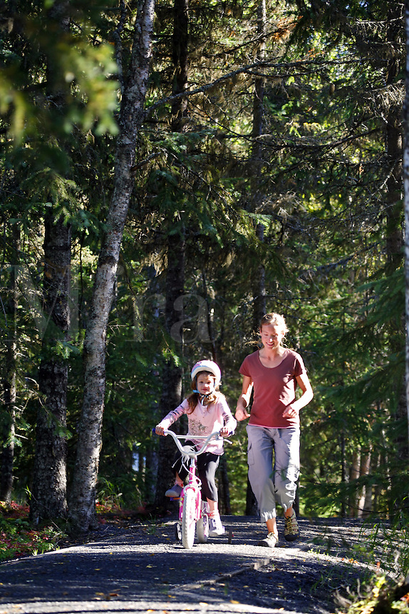 Family recreating at Trail Lake Campground, Kenai Peninsula, Chugach National Forest, Alaska.