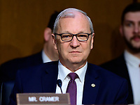 """United States Senator Kevin Cramer (Republican of North Dakota) listens to testimony before the US Senate Committee on Armed Services during a hearing on """"Chain of Command's Accountability to Provide Safe Military Housing and Other Building Infrastructure to Service members and Their Families"""" on Capitol Hill in Washington, DC on Thursday, March 7, 2019.<br /> Credit: Ron Sachs / CNP/AdMedia"""