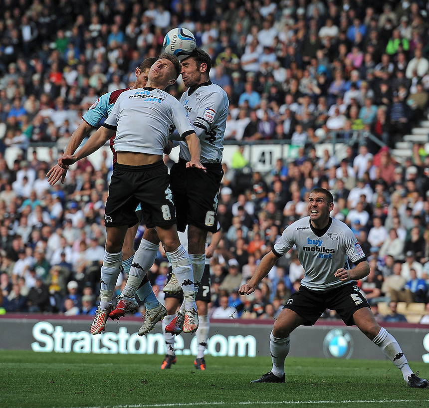 Derby County's Jeff Hendrick and Richard Keogh out jump Burnley's Chris McCann ..Football - npower Football League Championship - Derby County v Burnley - Saturday 22nd September 2012 - Pride Park - Derby..