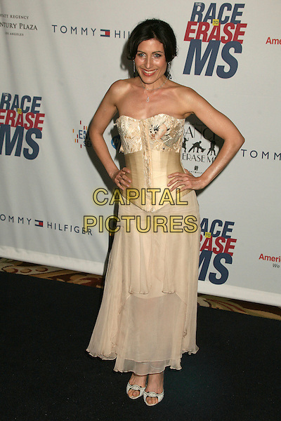 "LISA EDELSTEIN.14th Annual Race to Erase MS Themed ""Dance to Erase MS"" at the Century Plaza Hotel, Century City, California, USA, 13 April 2007..full length hands on hips cream gold corset strapless dress.CAP/ADM/BP.©Byron Purvis/AdMedia/Capital Pictures."