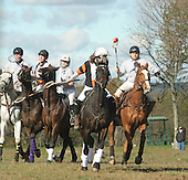 Patrick O'Reilly of Virginia (left), Katie McCrossin riding for the Warbucks and of Glenn Mills, Pa., Sara Harrington of North Carolina riding for the Grey Team and Carrie Hallhan of Warwick, NY riding for the Warbucks gallop after and try to take position of the ball away from David Brooks (right) of North Carolina who was riding for the Grey Team, during a polocrosse match held at the Bucks County Horse Park in Revere, Pa., on Sunday October 23, 2005. (JANE THERESE/Special to The Morning Call).