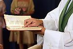Priest reading from the bible at a wedding in Stjarnop in Sweeden