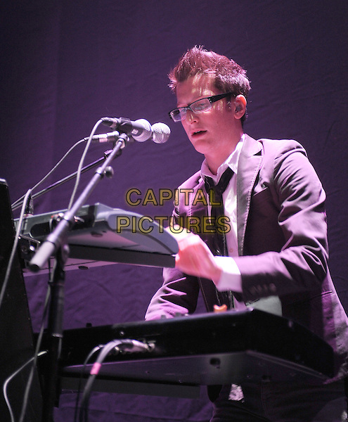 GARY GO (Gary Baker).performs live at The Palladium in Hollywood, California, USA, .October 23rd 2009                                                                  .music gig concert on stage .half length suit glasses grey gray playing keyboard microphone tie                                                     .CAP/RKE/DVS .©DVS/RockinExposures/Capital Pictures