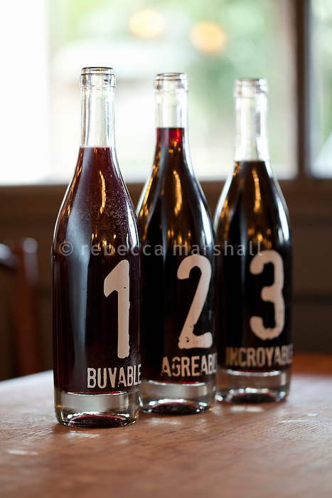 Bottles serving three types of house wine at Bouchon restaurant, Monaco, 23 March 2012