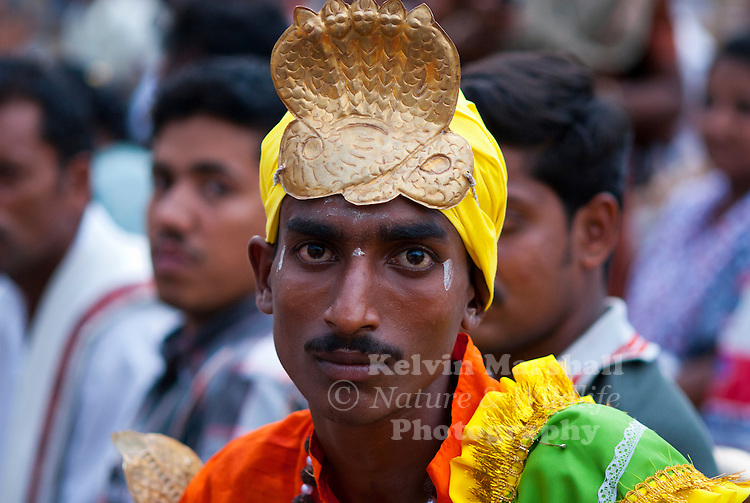 Indian man dressed in traditional clothing attending a local festival. Mysore, Kerala (Southern India).