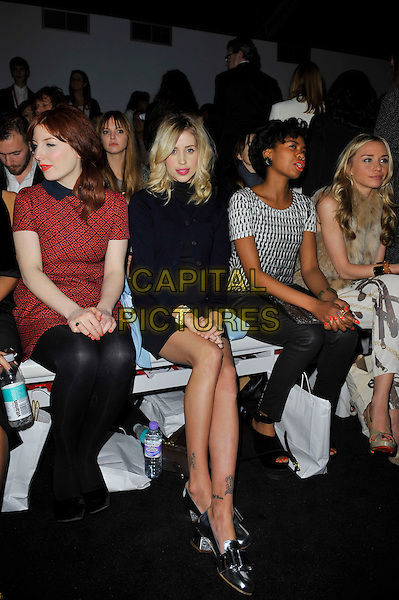 Alice Levine, Peaches Geldof, Tolula Adeyemi & Noelle Reno.at PPQ Autumn/Winter LFW a/w 2013 show at London Fashion Week, Somerset House, London, England..15th February 2013.LFW full length blue cardigan black silver shoes top beige fur dress pregnant red pattern dress sitting .CAP/MAR.© Martin Harris/Capital Pictures